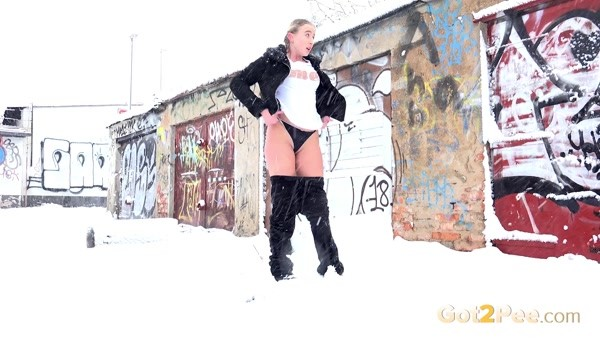Young beauty pees in a blizzard (FullHD 1080p)