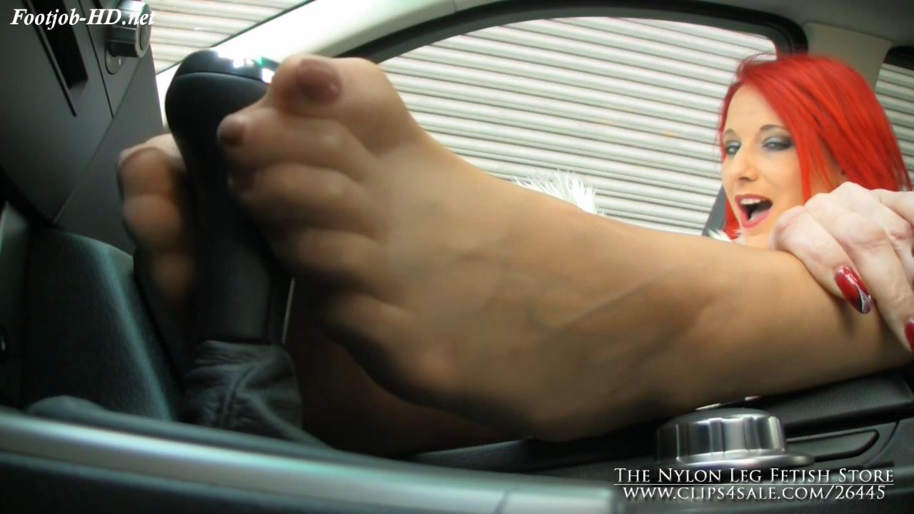 Footjob_on_gear_shift_in_car_-_The_Nylon_Leg_Fetish_Store.jpg