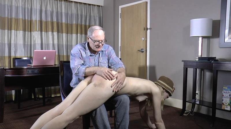 After several warnings, he threatens her with a spanking if she doesn't put something on.