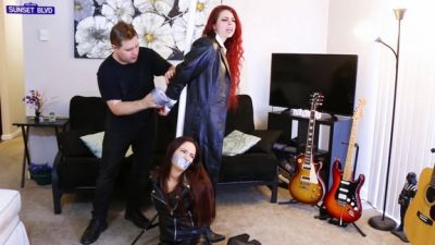 Two Redhead Spies In Leather Get Tied Up And Gagged During A Mission!