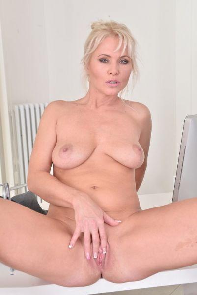 Kathy masturbates in the office
