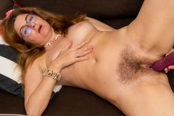 Voyeuristic teacher plays with her hairy pussy