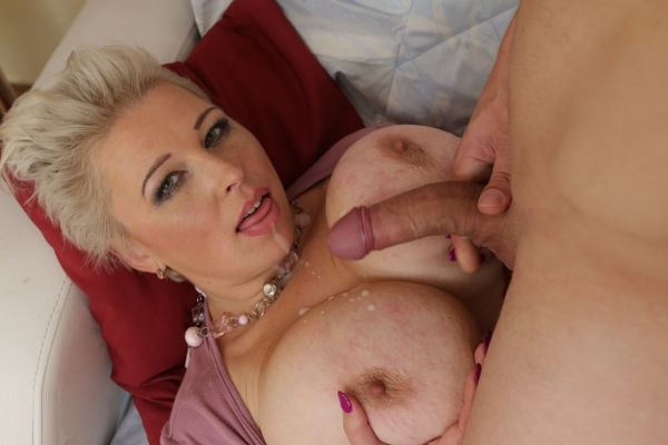 Attractive mature lady with giant natural tits get fucked by a Toyboy