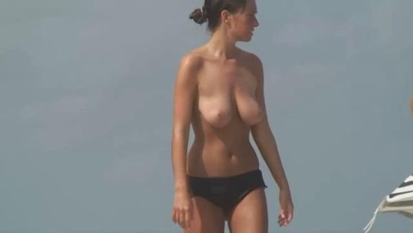 Voyeur Natural beauty strips nude on beach