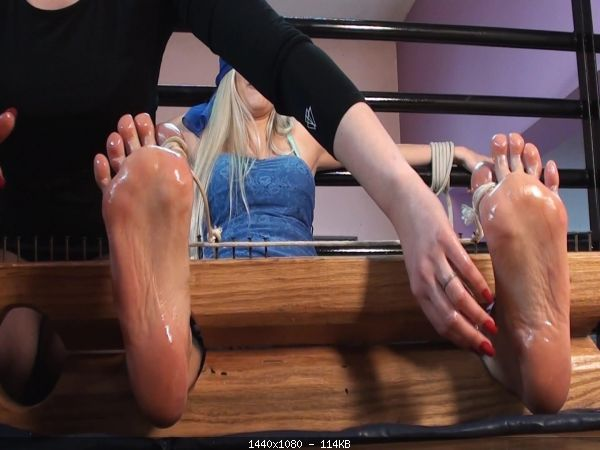 Tickling_41-Huanita_blindfolded_and_toe_tied_in_stocks.jpg